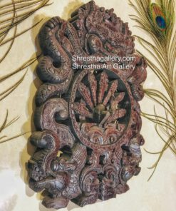 carved wooden peacock and bhairav